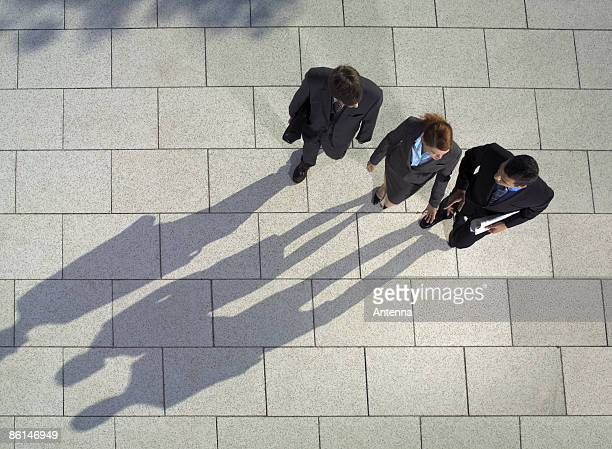 Three business people walking