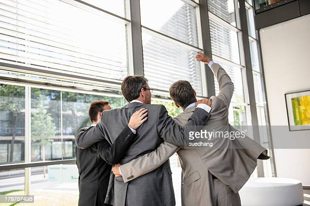 Three businessmen celebrating