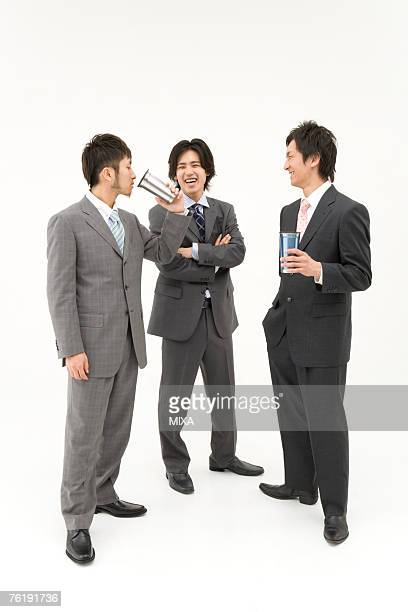 Three businessmen drinking and talking
