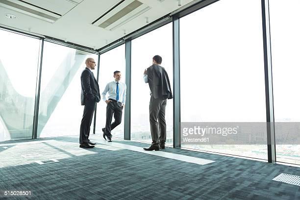 Three businessmen in office