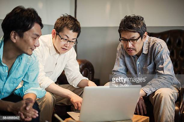 Three Businessmen meeting in a cafe