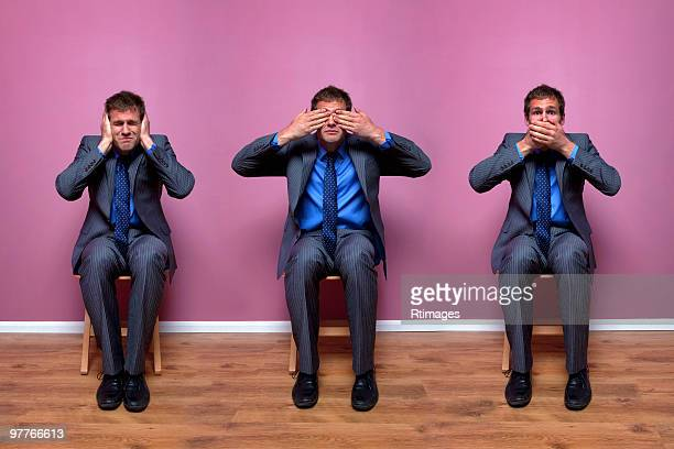 three businessmen sitting in chairs - see no evil hear no evil speak no evil stock pictures, royalty-free photos & images