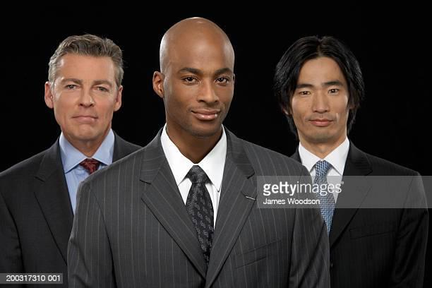 Three businessmen smiling, portrait, close-up