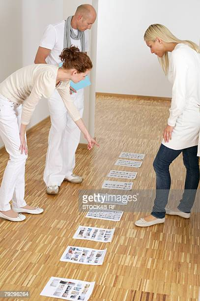 Three businesspeople choosing images
