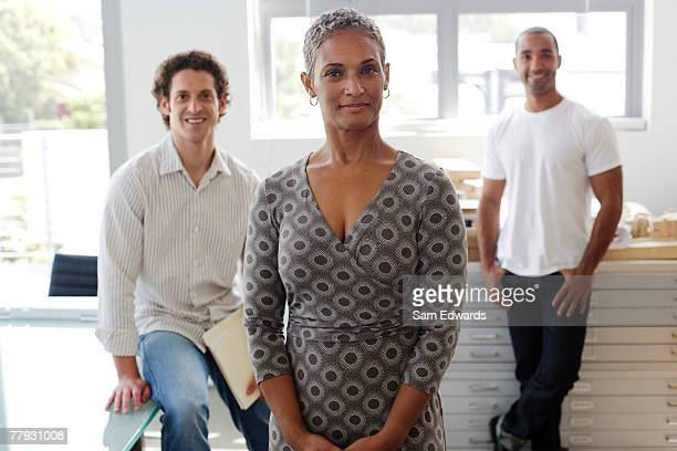 three businesspeople in an office - older woman younger man stock photos and pictures