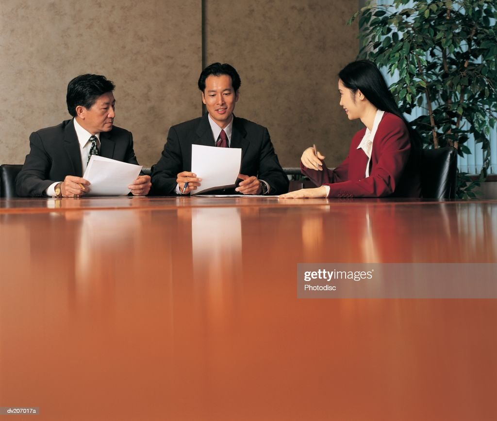 Three businesspeople in meeting : Stock Photo
