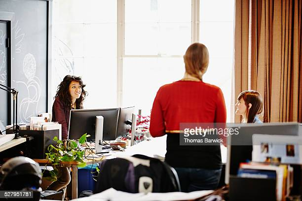 Three businesswomen in discussion in office