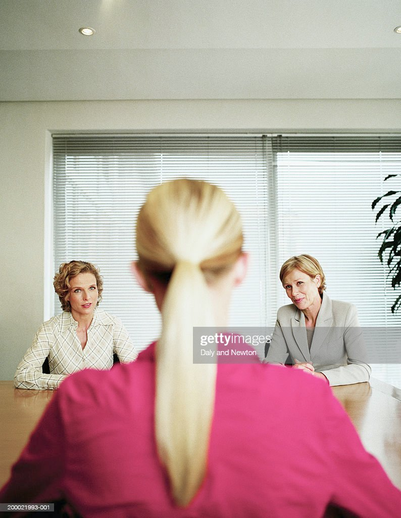 Three businesswomen in discussion (focus on women in background) : Stock Photo