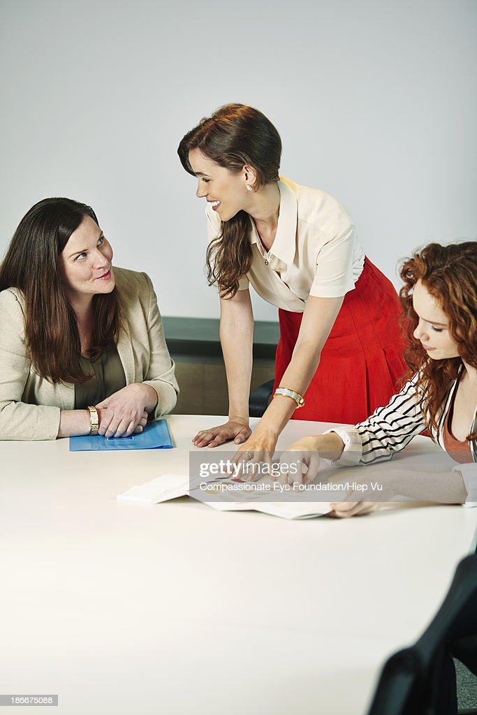 Three businesswomen in office meeting room : Stock Photo