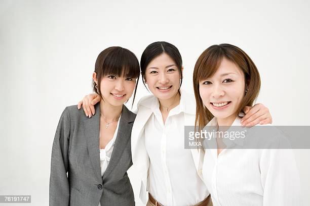 Three businesswomen looking at camera