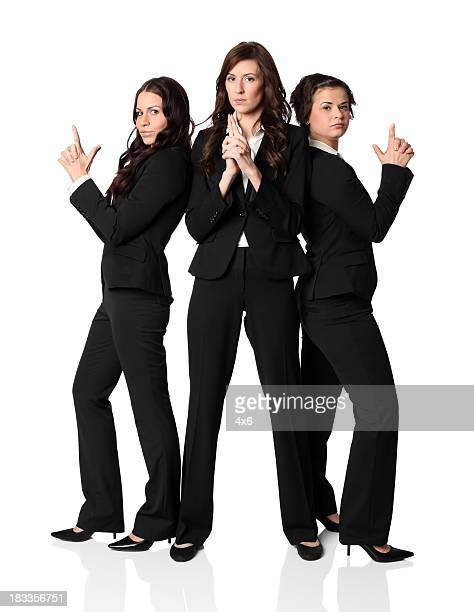 three businesswomen posing - secret agent stock pictures, royalty-free photos & images