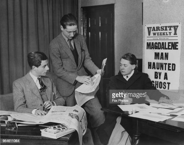Three Cambridge undergraduates at work on the University's newspaper, 'Varsity Weekly', UK, 23rd January 1933. From left to right, they are the...
