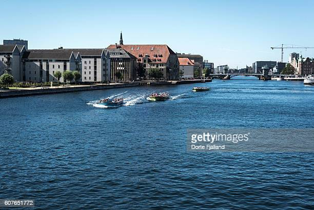 three canal tour boats in copenhagen harbour - dorte fjalland stock-fotos und bilder