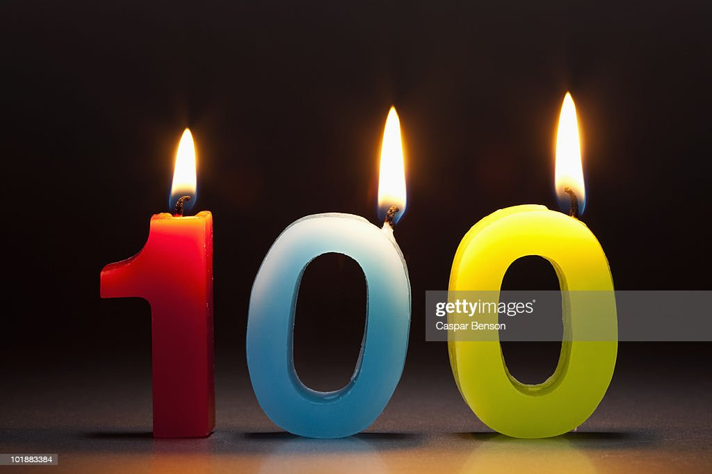 Three Candles In The Shape Of The Number 100 : Stock Photo