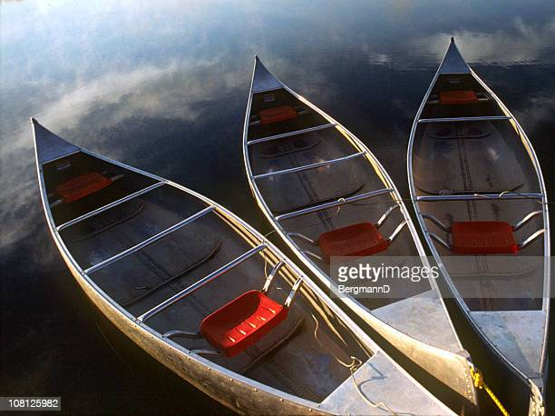 three canoes floating in calm water - kansas stock pictures, royalty-free photos & images
