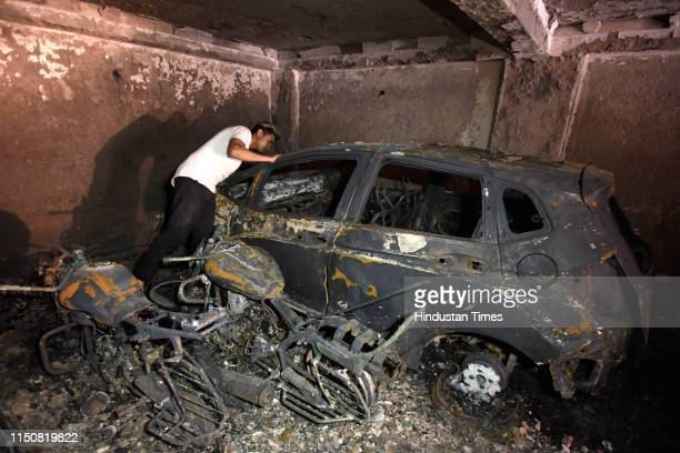 Three cars and several twowheelers parked in the ground floor of a building got gutted in an overnight fire incident at Abul Fazal Jamia Nagar on...
