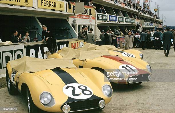 Three cars of the Ecurie Nationale Belge in the pit lane before the 24 Hours of Le Mans Race June 1957 Car no 28 is a Ferrari 500TR which was driven...