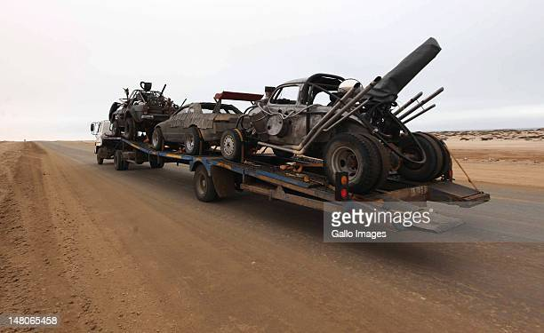 "Three cars used in the film ""Mad Max 4: Fury Road"", are transported to the dunes outside Swakopmund where the film is currently being filmed on July..."