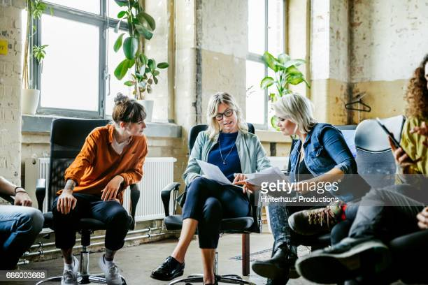 Three casual businesswomen discussing during meeting