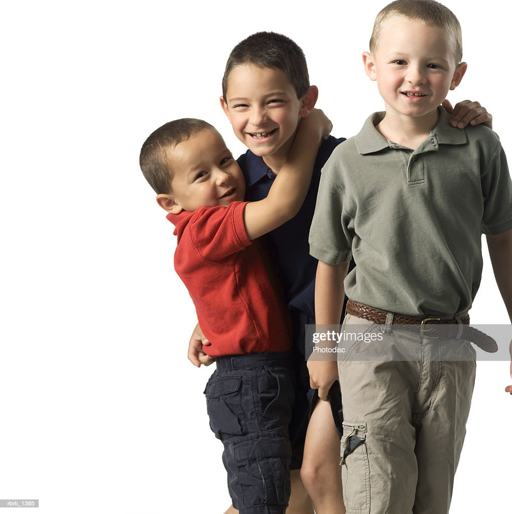 three caucasian child brothers play around with each other : ストックフォト