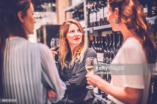 Three Caucasian Female Friends Talking in a Wine Bar