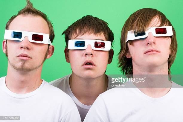 three caucasian teenage boys staring through 3d glasses - redoubtable film stock photos and pictures
