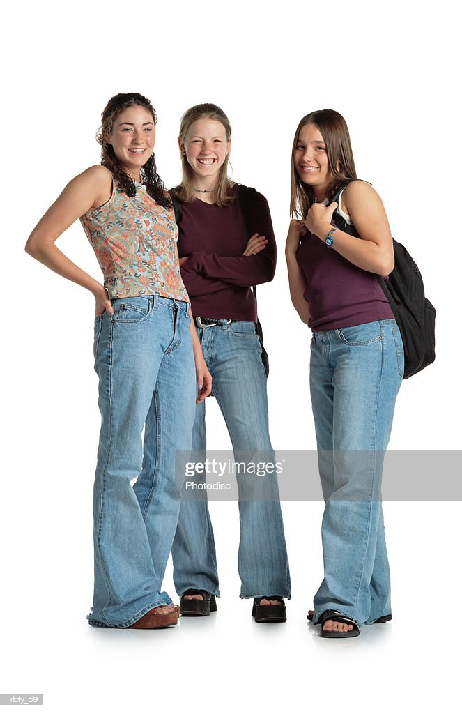 three caucasian teenage girls smile while looking into the camera : Foto de stock