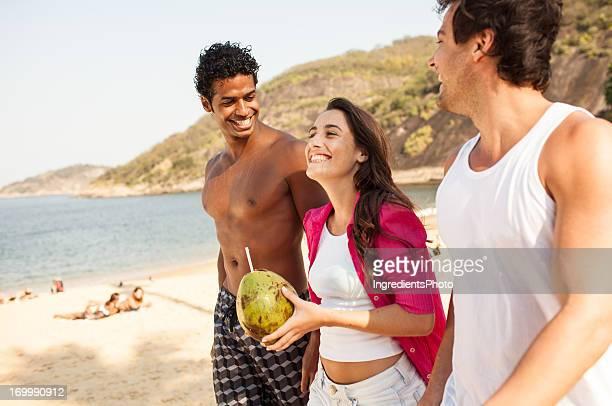 Three cheerful friends have fun on the beach.