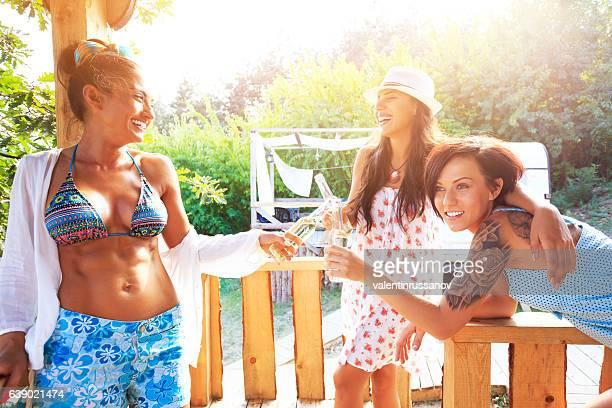 Three cheerful women having fun on veranda