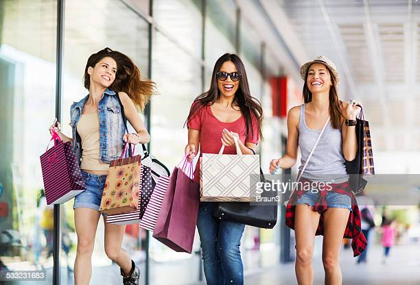 Three cheerful women in shopping.