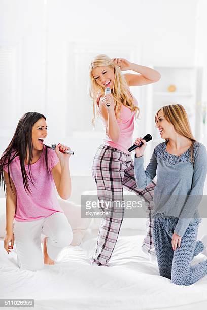Three cheerful women singing.