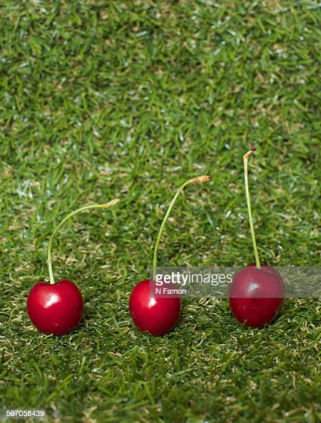 Three cherries in a line.