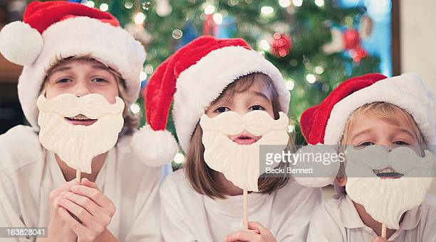 Three Children dressed as Santa with White Beards