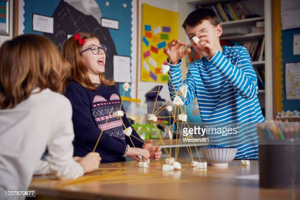 three children during a science lesson - craft stock pictures, royalty-free photos & images
