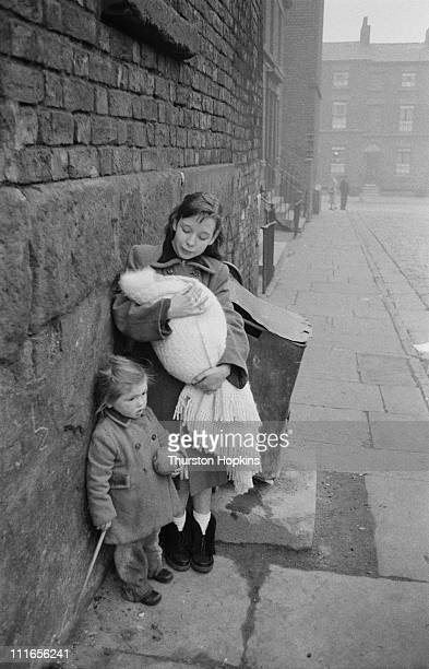 Three children in a slum area of Liverpool 19th November 1956 Original publication Picture Post 8995 Liverpool Slums unpub