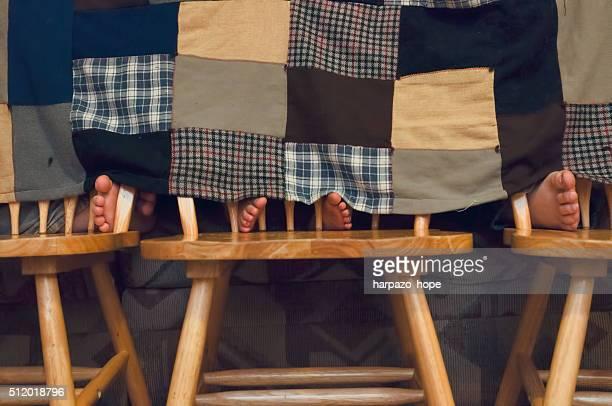Three Children in in a blanket fort.
