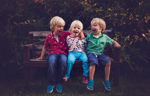 Three children laughing together - gettyimageskorea