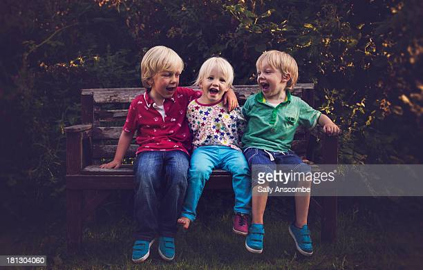 three children laughing together - children only stock pictures, royalty-free photos & images