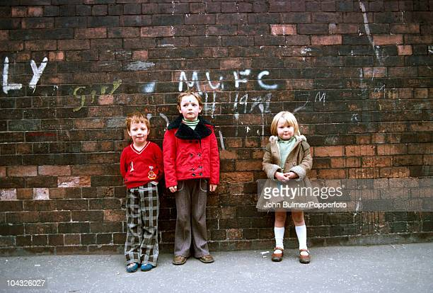 Three children on a street in Manchester England in 1976