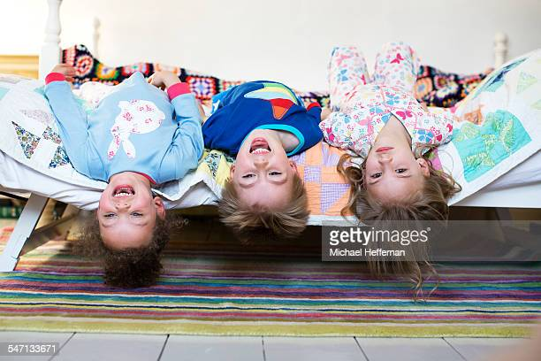 three children playing on bed - children only stock pictures, royalty-free photos & images