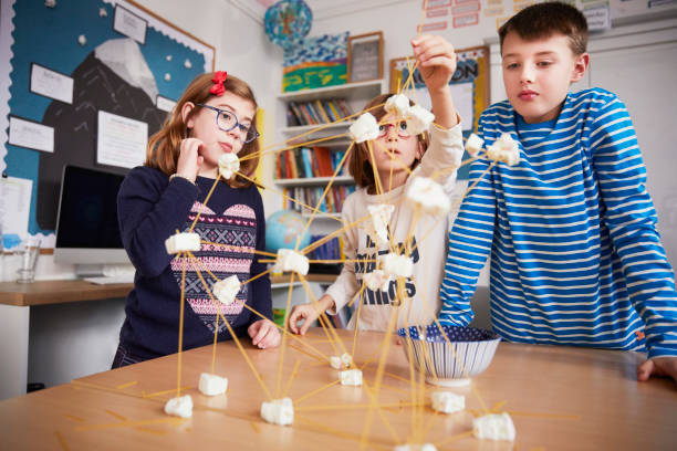 Three children setting up construction during a science lesson