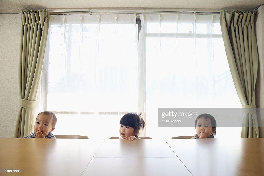 Three children sitting on the chair. : Stock-Foto