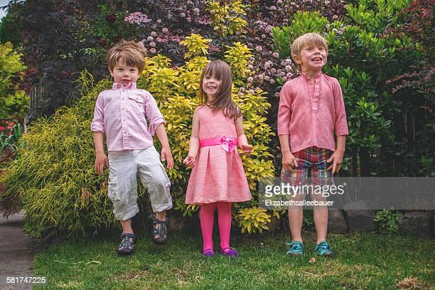 Three children standing in a row