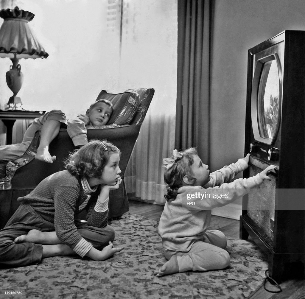 Sitting Close To The TV : News Photo
