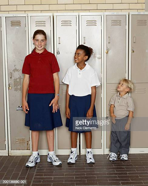 Three children (2-12), younger children looking up at oldest child