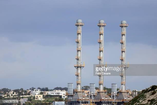three chimneys of a liquefied natural gas (lng) power plant system - 液化天然ガス ストックフォトと画像