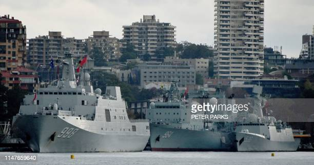 Three Chinese warships are seen docked at Garden Island naval base in Sydney on June 3, 2019. - Australians were surprised by the sight of three...