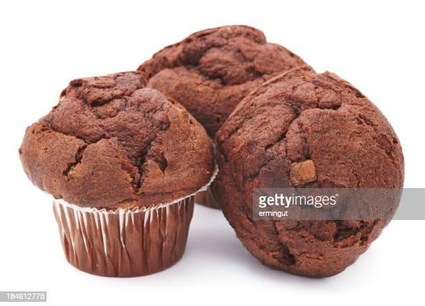 Three chocolate muffins isolated on white