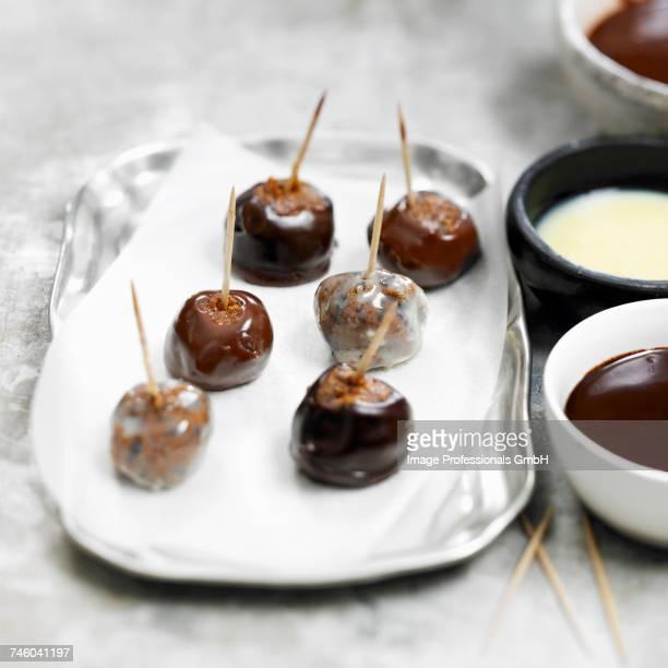 Three chocolate prune candies