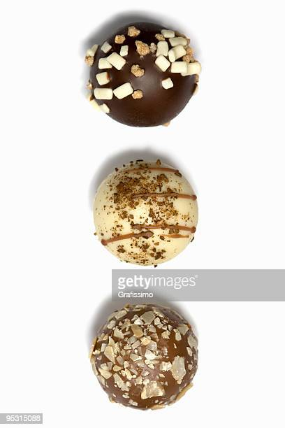 three chocolate truffles in a row - marzipan stock pictures, royalty-free photos & images